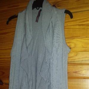 small gray sleeveless open front overlay top